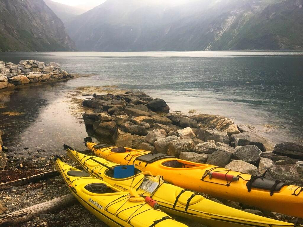 Kayaks parked at a campsite in Norway