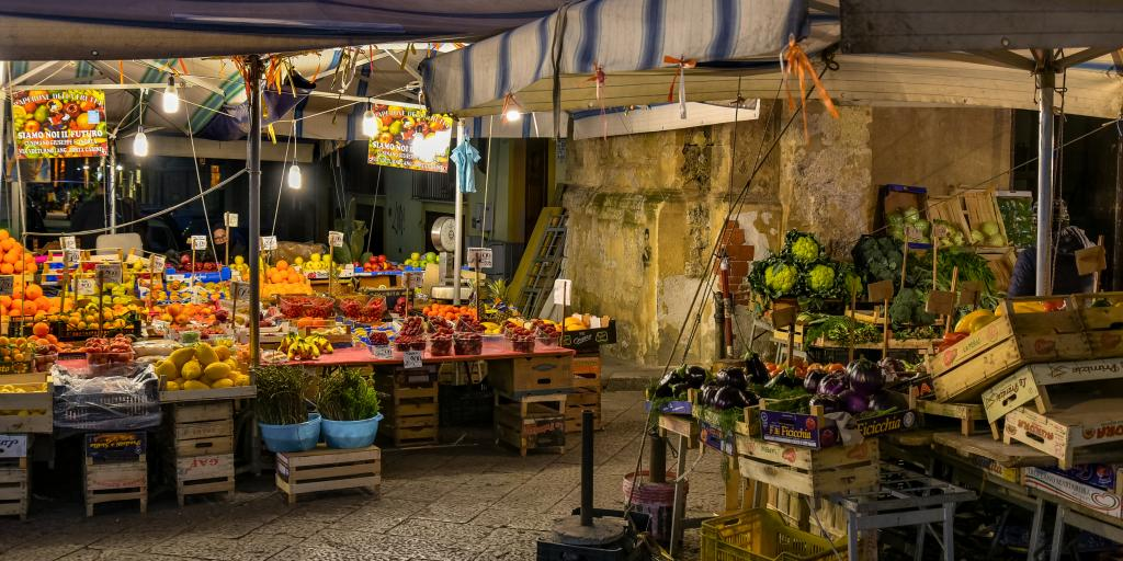 Fresh fruits and vegetables on display in wooden crates at Mercato Il Capo in Palermo, Sicily