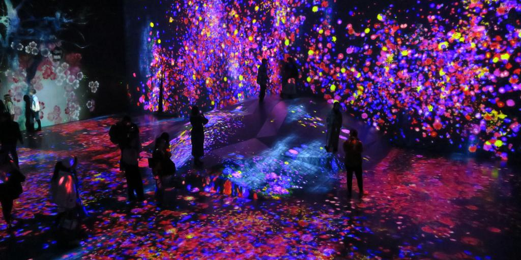People immersed in the colourful digital art of the teamLab Borderless Museum, Tokyo