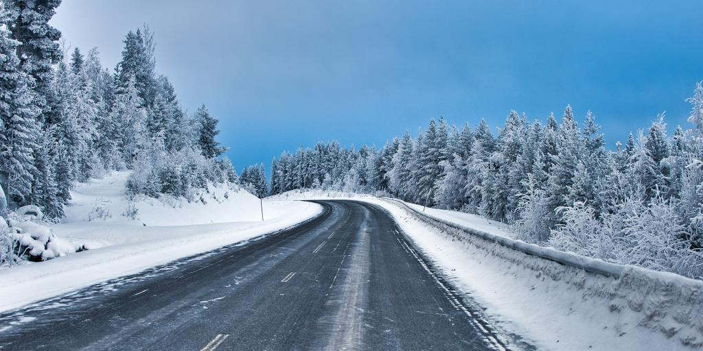 A snowy road on a sunny day