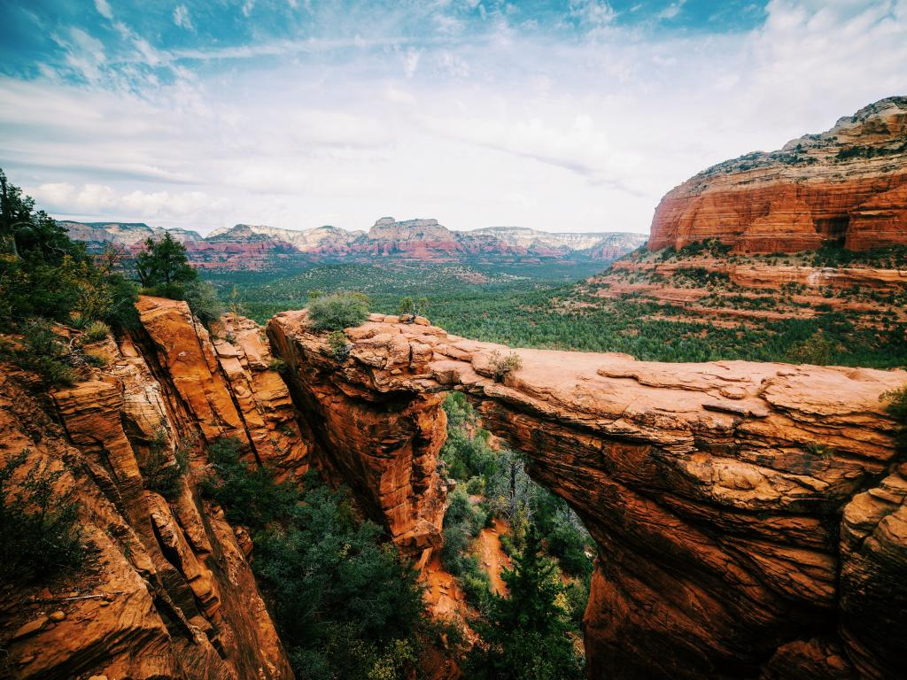 Broad angle view of the panoramic landscape of the Devils Bridge Trail in Sedona, Arizona.