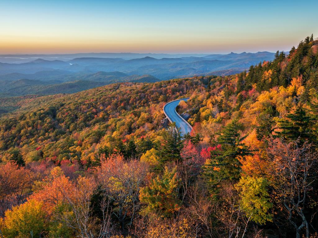 The Blue Ridge Parkway road running through mountains and forests along the Lynn Cove Viaduct in North Carolina.