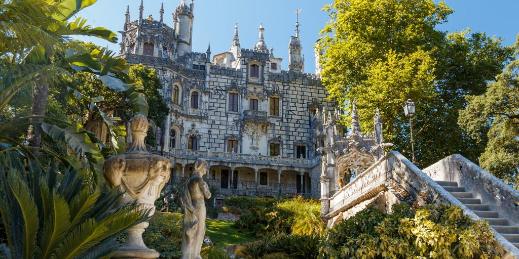 Palace surrounded by trees in Quinta de Regaleira, Sintra