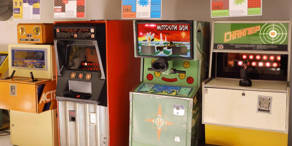Four old arcade machines lined up against a wall at the Museum of Soviet Arcade Machines, Moscow