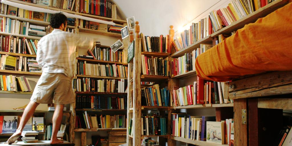 A man rifles through the bookshelves at Atlantis Books in Santorini