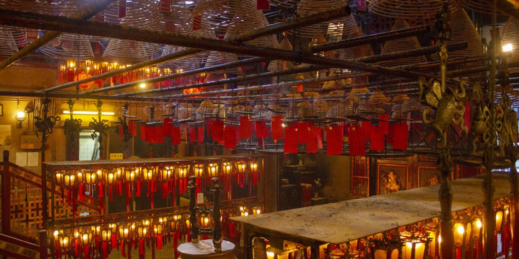 The inside of the Mo Man temple, Hong Kong, with lots of lanterns lit