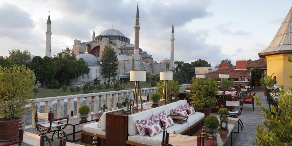 Sofas and chairs on the terrace at Four Seasons at Sultanahmet in Istanbul, with Hagia Sophia in the background