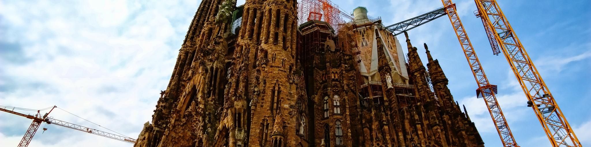 Cranes surround the towers of the unfinished La Sagrada Familia church in Barcelona, designed by Gaudi