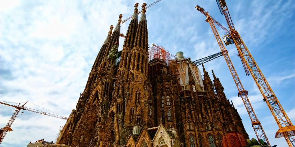 Cranes surround the towers of the unfinished La Sagrada Familia church in Barcelona, designed by Gaudi
