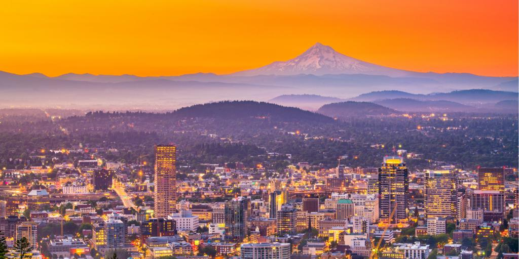 The skyline of Portland, Oregon, at sunrise with Mt Hood on the horizon
