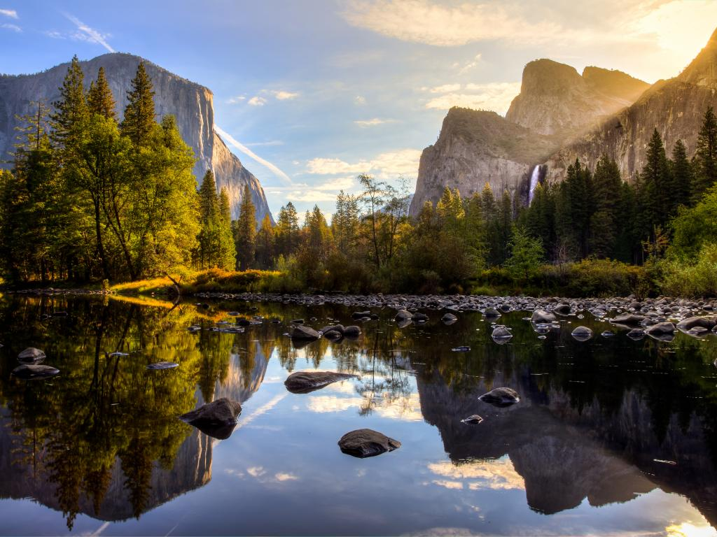 View of Yosemite Valley at sunrise from the Merced River, California.