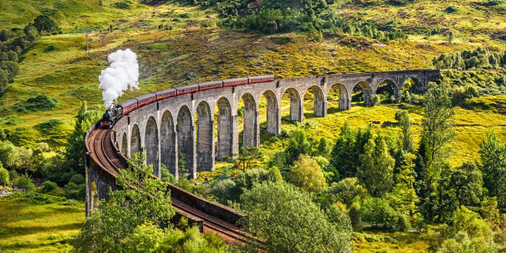 A train going over the Glenfinnan Viaduct in Scotland
