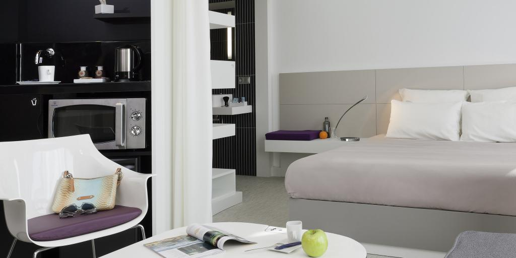 A bedroom in the Novotel Suites Den Haag City Centre hotel in the Hague, Netherlands