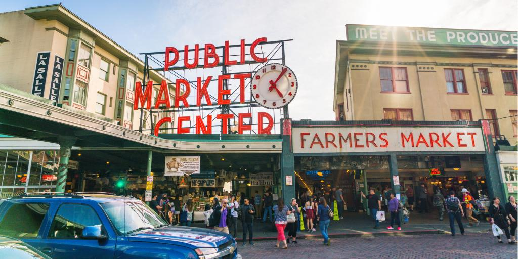 People visit the popular Pike Place Market in Seattle on a sunny day