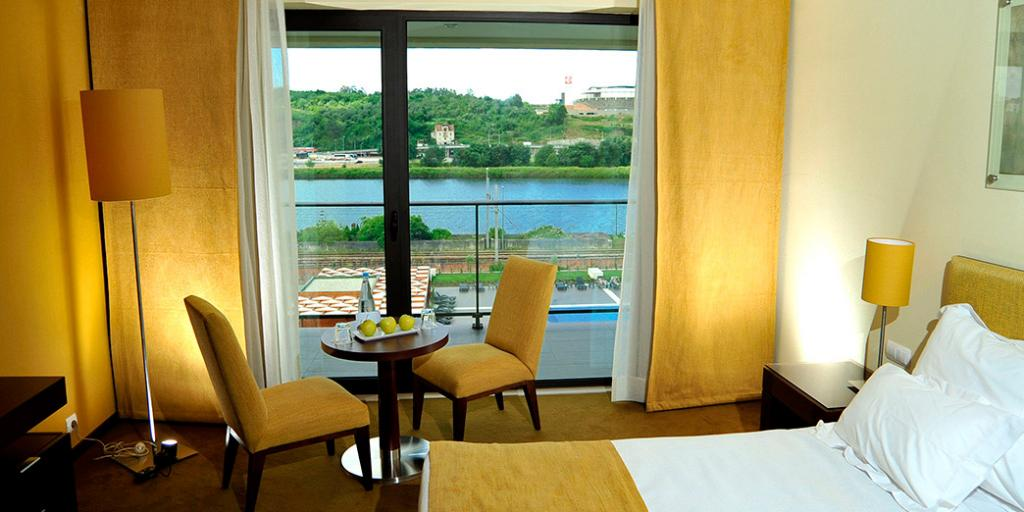 A bedroom with a view in Vila Galé Coimbra hotel in Portugal