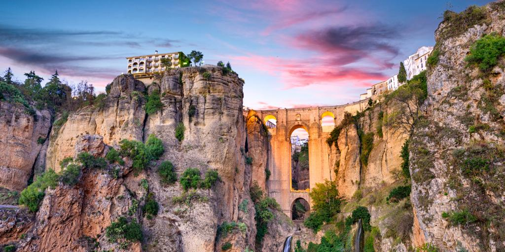 Puente Nuevo Bridge in the city of Ronda, Spain, at sunset