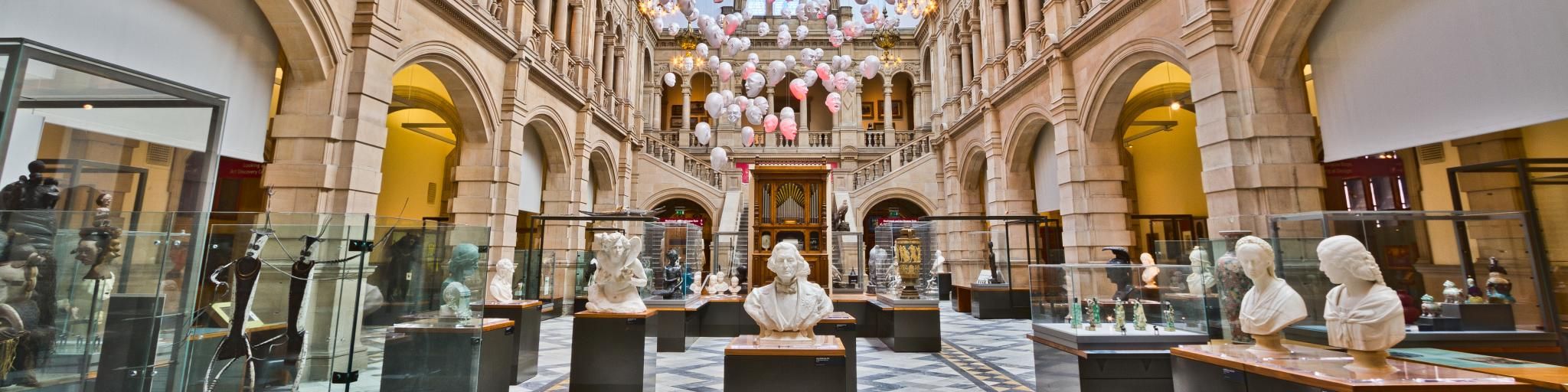 Busts and works of art on display in the immense and beautiful hall at Kelvingrove Art Gallery