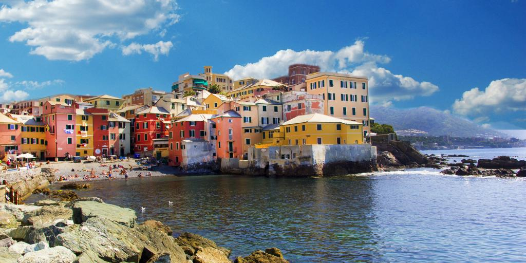 colourful houses hug the coastline in Genoa, north Italy