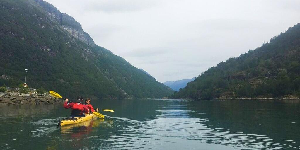 Setting off in a two-person kayak in the fjords of Norway