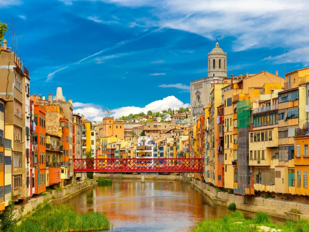 Colorful houses and Eiffel Bridge, old fish stalls in Girona