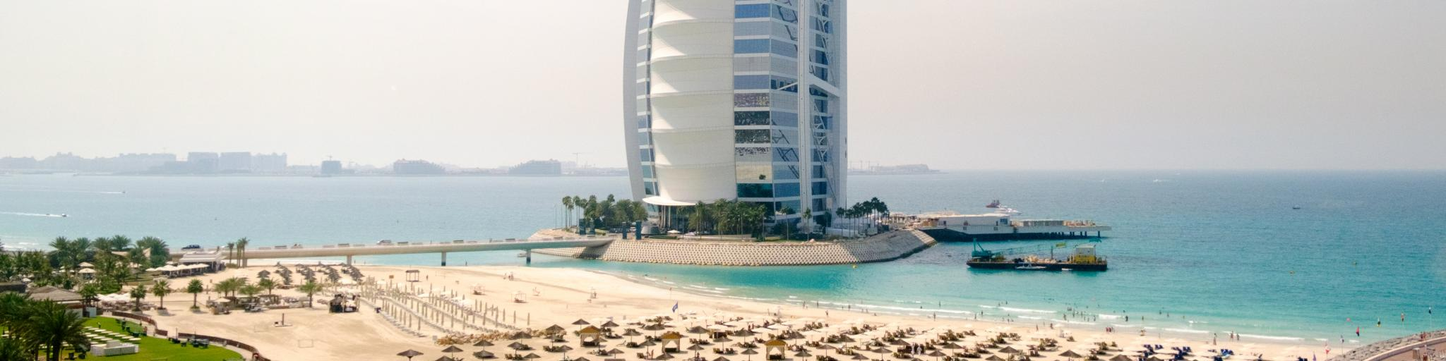 The iconic Burj Al Arab building dominates the shoreline of Dubai, UAE