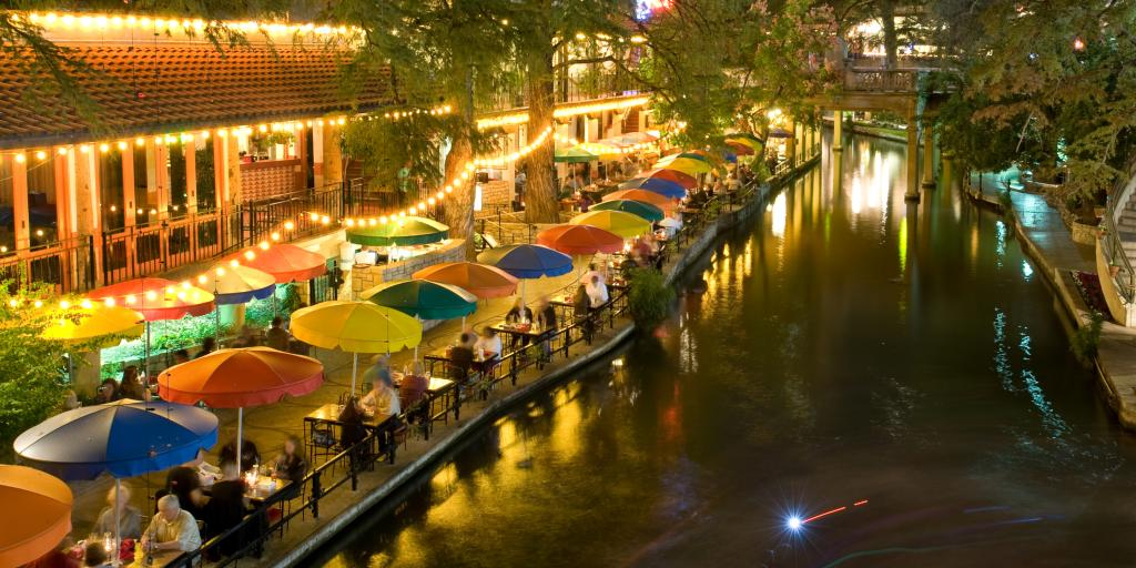 San Antonio Riverwalk by night with people enjoying dinner