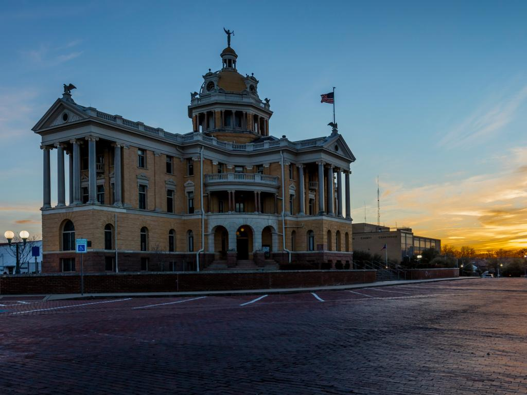 Harrison County Courthouse building at dusk in Marshall, Texas