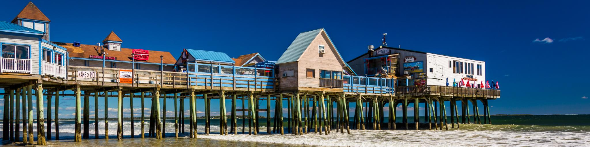 The colorful Old Orchard Beach Pier in Maine has restaurants and bars with a view.