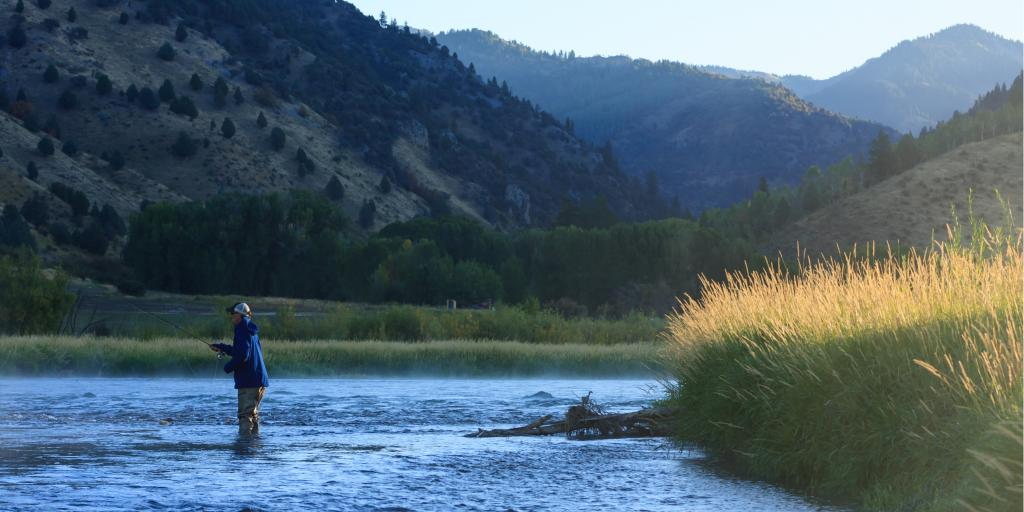 A man goes fly fishing on Snake River in Swan Valley, Idaho