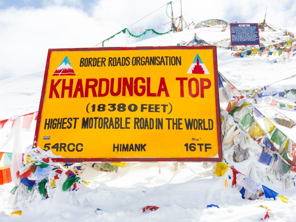 Khardung La pass has a slightly ambitious sign at the top that exaggerates its height to claim the highest road in the world status