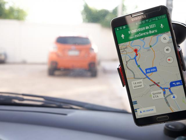 The Google Maps app on a phone screen in a car