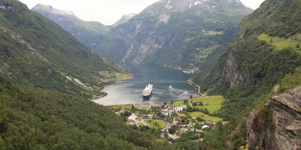 A cruise sails into the port in Geiranger, Norway