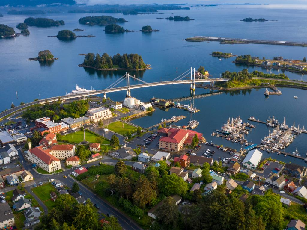 The picturesque town of Sitka on Baranof Island, Alaska with a bridge, marina and small islands in the background