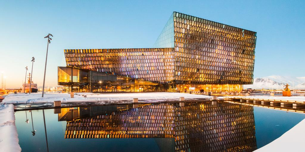 The Harpa Concert Hall, Reykjavik reflected on the water in the early evening