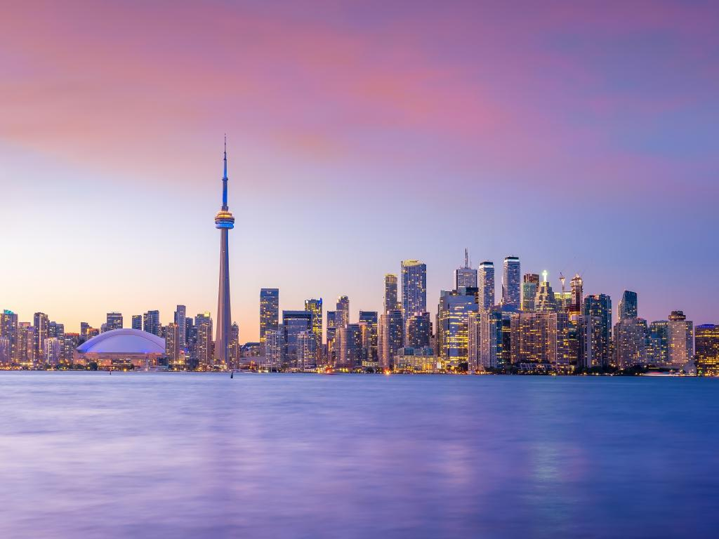 Toronto skyline from across the water at sunset.