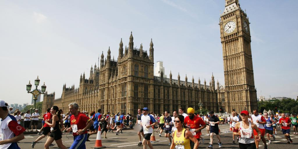 Runners passing Big Ben during the London Marathon