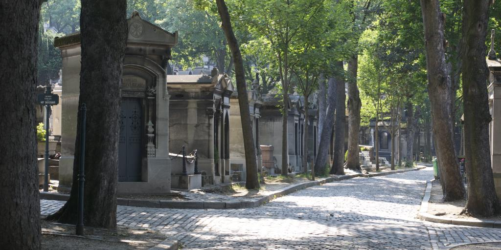 Shaded walking paths in Père Lachaise cemetery in Paris