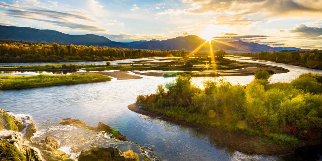 The sun rises over Snake River in Idaho's Swan Valley