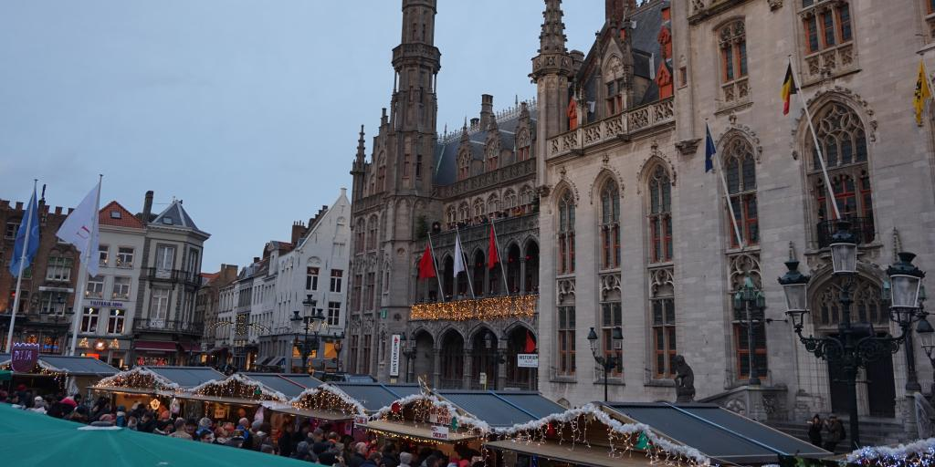 Chalets and Provinvaal Hof at Bruges Christmas market, Belgium