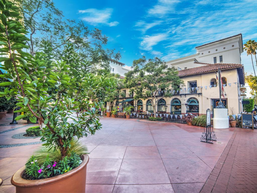 A typical square in Santa Barbara with restaurant tables outside in perfect weather.