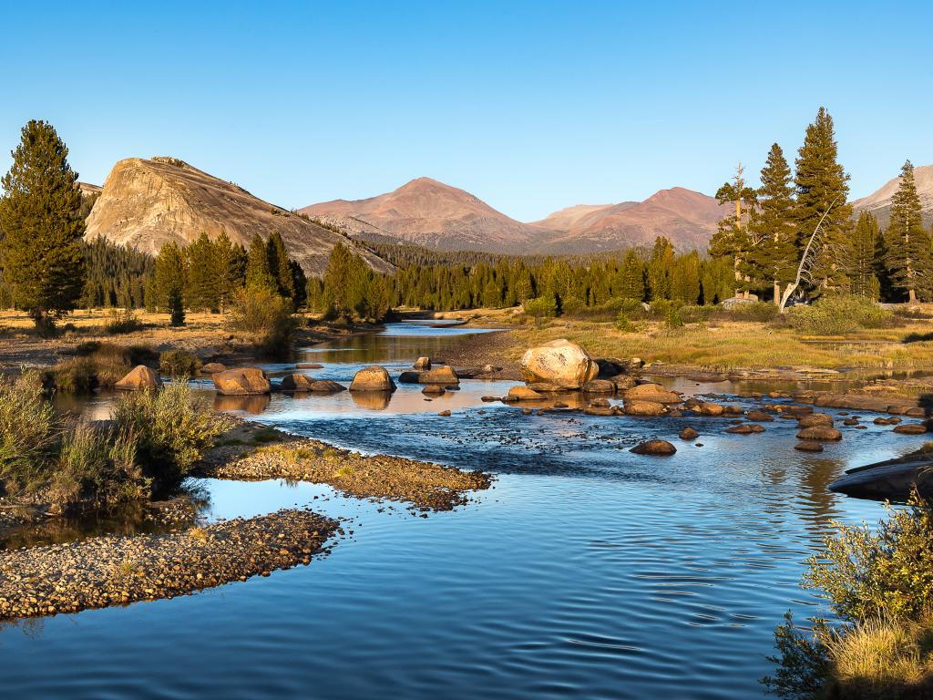 Tuolumne Meadows are a tranquil place to hike along the river with Yosemite sights in all directions.