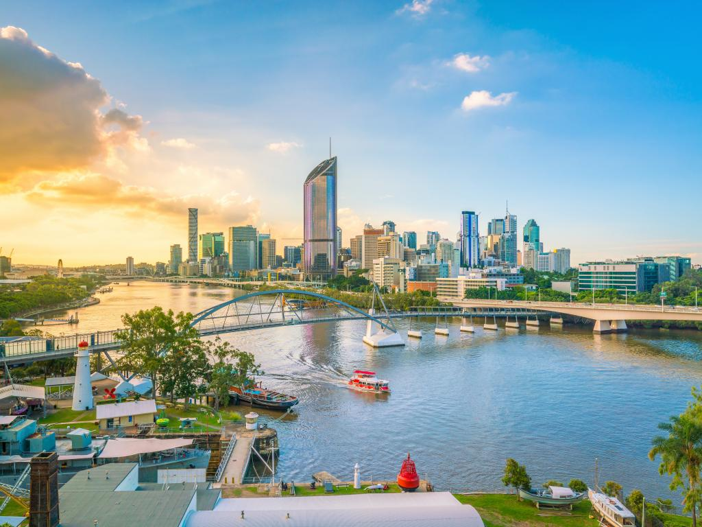 Skyline of Brisbane, Queensland, Australia in the afternoon with the Brisbane River in the foreground.