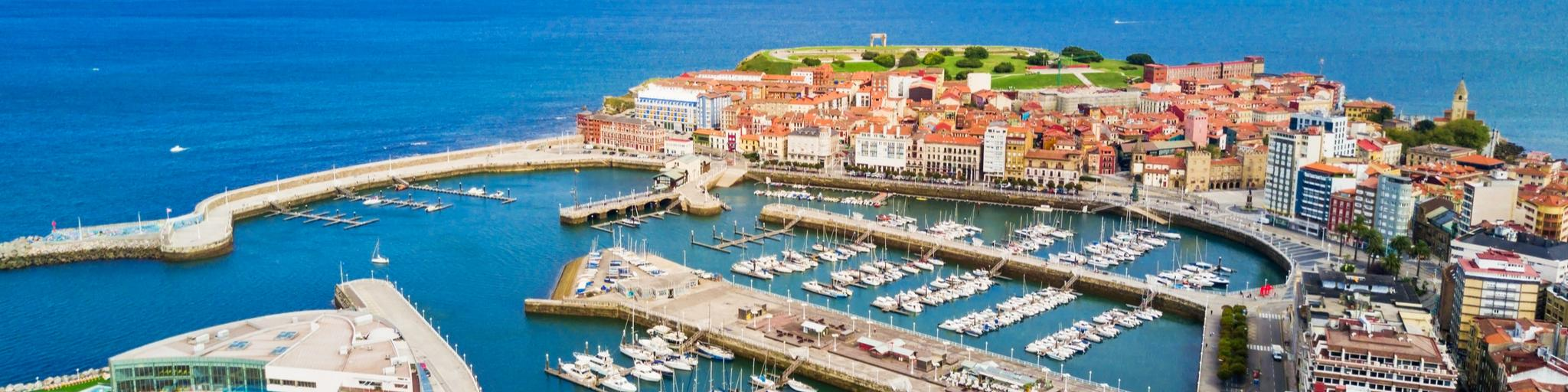 An aerial view of Gijon harbour on a sunny day