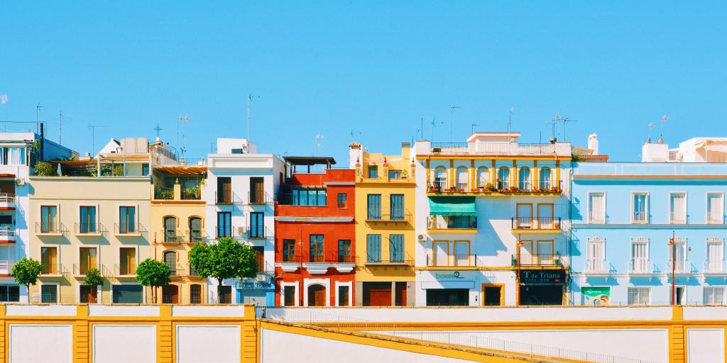 Colourful houses line the waterfront in Seville's Triana neighbourhood, on the left side of Guadalquivir river