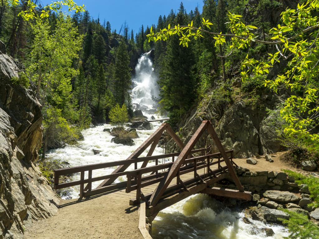 A bridge over the white water of Fish Creek Falls near Steamboat Springs, Colorado