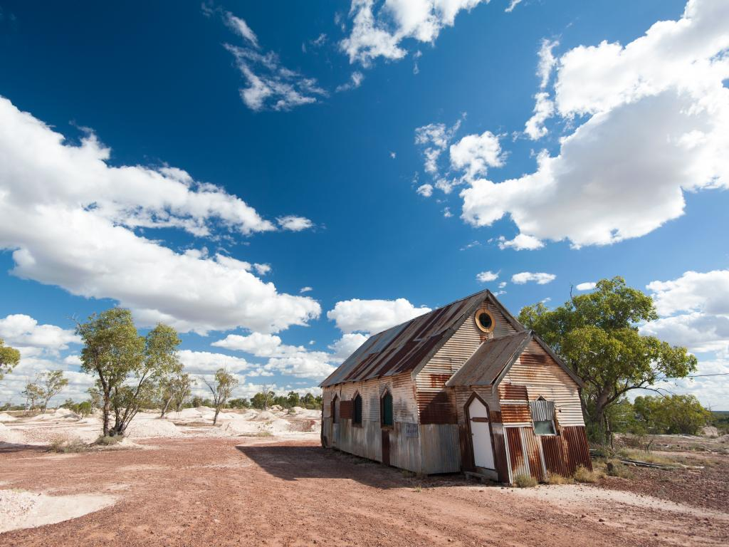 The rusty old church is one of the iconic sights in Lightning Ridge on a road trip from Sydney.