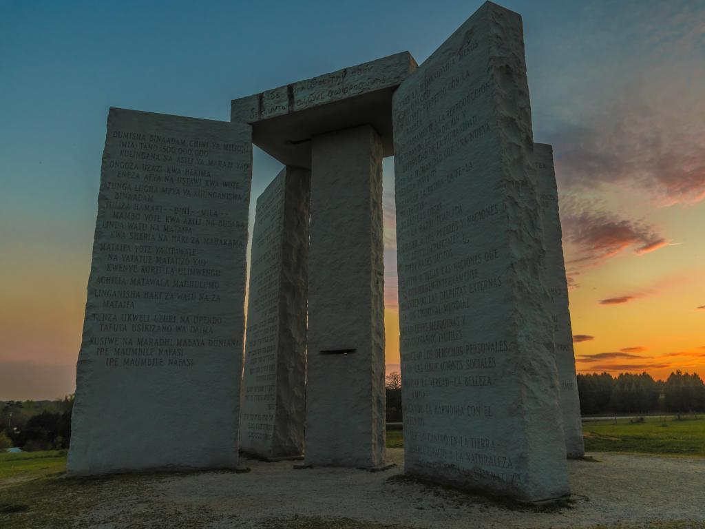 The Georgia Guidestones with 10 principles inscribed in 12 different languages at sunset