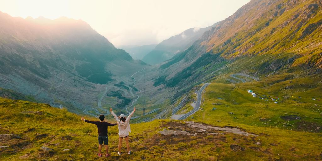 A couple enjoying views of the Transfagarasan, Romania