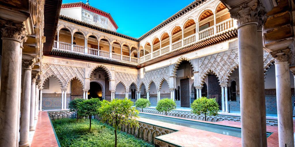 A beautiful moorish Alcazar courtyard on our Spain road trip