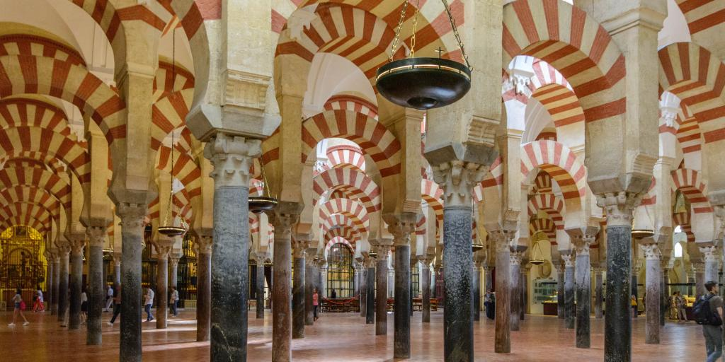 Moorish-inspired archways inside the Mezquita Cathedral in Cordoba, Spain